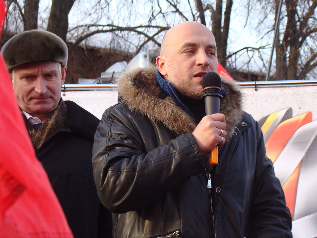 1024px Nikolay Ryabov and Zakhar Prilepin on tribune Nizhny Novgorod rally 4 February 2012