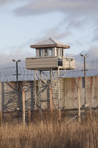 Prison guard lookout tower 157541738 837x1255