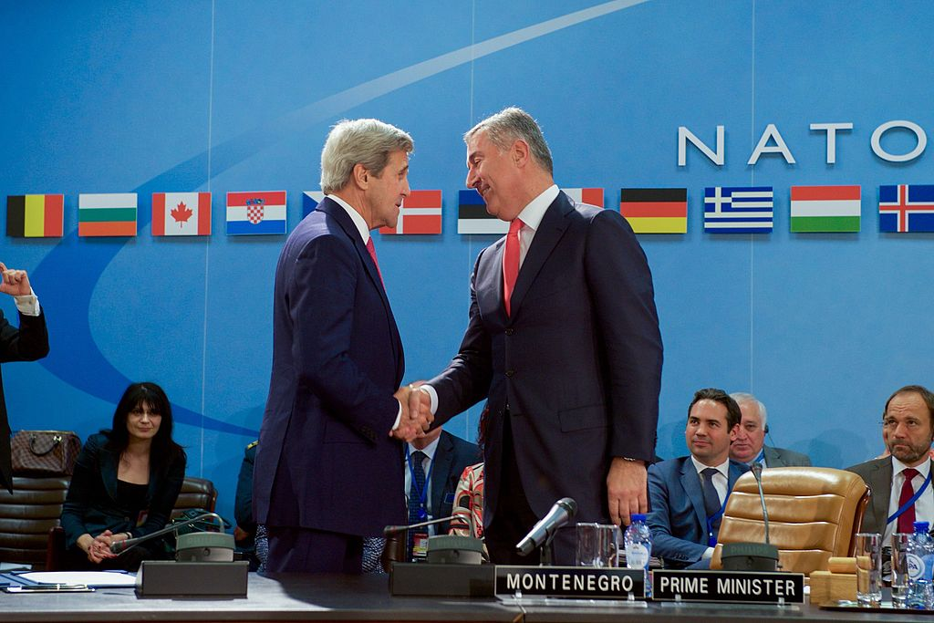Secretary Kerry Shakes Hands With Montenegrin Prime Minister Djukanovic After Signing an Accession Protocol to Continue Montenegros Admission to NATO in Brussels 27113868975